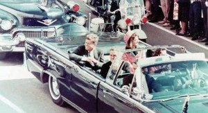 President John F. Kennedy, First Lady Jacqueline Kennedy, and Texas Governor John Connally ride in a motorcade in Dallas, Texas, on November 22, 1963.  Moments later the President and Governor were shot by an assassin. (Walt Sisco / Copyright Bettmann/Corbis / AP Images)