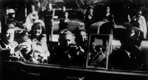 John F. Kennedy and his wife Jacqueline drive through Dallas shortly before his assassination. | Getty